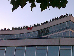 Demonstrators on the roof above Tory HQ
