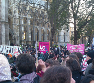 Trade union banners beside Parliament Square during demo
